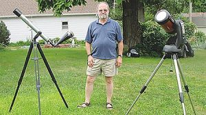 Burt Watson with two of the telescopes he has prepared for viewing the total solar eclipse.