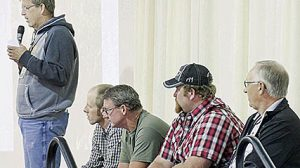 FARMER PANEL -- Matt Niewohner, l., speaks during the soils conference. Other panelists looking on, l.-r., are John Krohn,  Todd Buettner, Tyler Foland and Paul Kettelson.