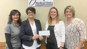 Valero Renewables - Albion employees, l.-r., Sheila Carder and Jolynn Groeteke present the Valero Energy Foundation grant for two new video laryngoscopes to Boone County Health Center employees Jenni DeWitt and Aprill Murphy.