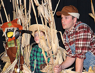 Cooper and Justin DeWitt in the cornfield.