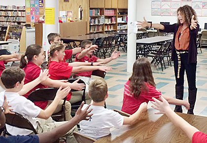 Artist in Residence Rita Paskowitz works with sixth graders at St. Michael's on Monday.
