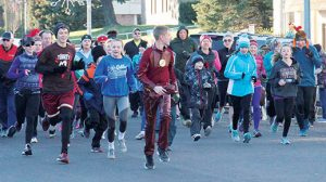 Turkey Trot participants start the 3.1 mile run on Thanksgiving Day in Albion.