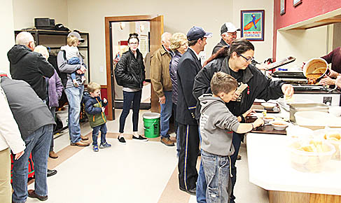 Lineup for the chili supper inside the Vets Club.