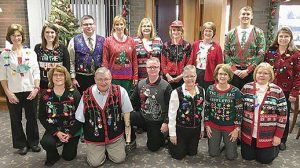 Cornerstone Bank and Cornerstone Insurance employees in their ugly sweaters.