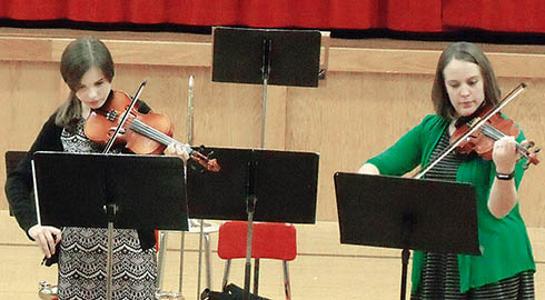 Boone Central Concert on Dec. 18 featured Jill Nore, l., and Whitney Paulson playing a violin duet.