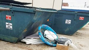 Dumpster at Albion City Hall, where a plastic swimming pool and Styrofoam  had to be removed.