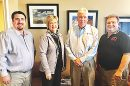 AGENCY PURCHASE -- Brady R. Yosten, sales manager with CVIA; Denise Tonniges, branch manager of First Insurance Agency; David Meek, president, First Bank of Utica, and Brian Yosten, president of CVIA.