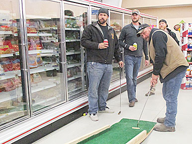 Lining up putts at the Rae Valley Market hole.