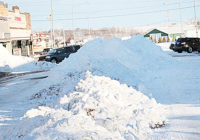 Snow was piled high in the middle of Main Street during clean-up Tuesday.
